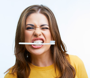 Girl Biting Toothbrush